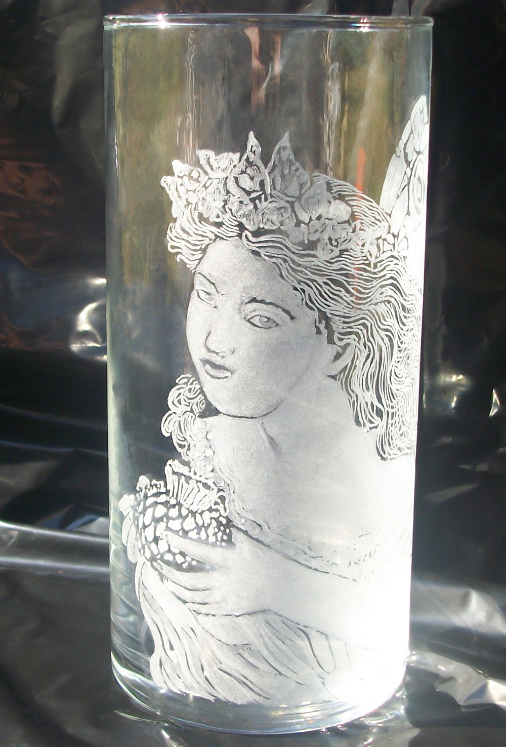 Hand engraved glass fairy vase